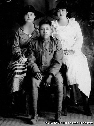 Choctaw code talker Joseph Oklahombi with family