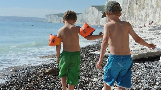 Two children playing on a beach
