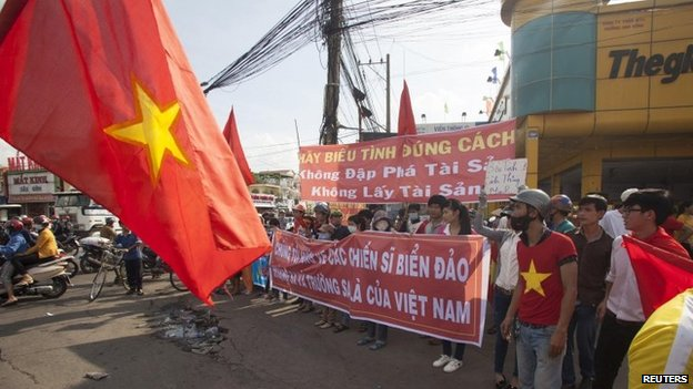 Workers hold banners during a protest in an industrial zone in Binh Duong province on 14 May 2014
