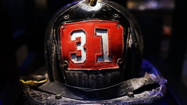 Surviving firefighter Dan Potter's fire helmet, which he used at Ground Zero on September 11, is viewed during a tour the National September 11 Memorial Museum