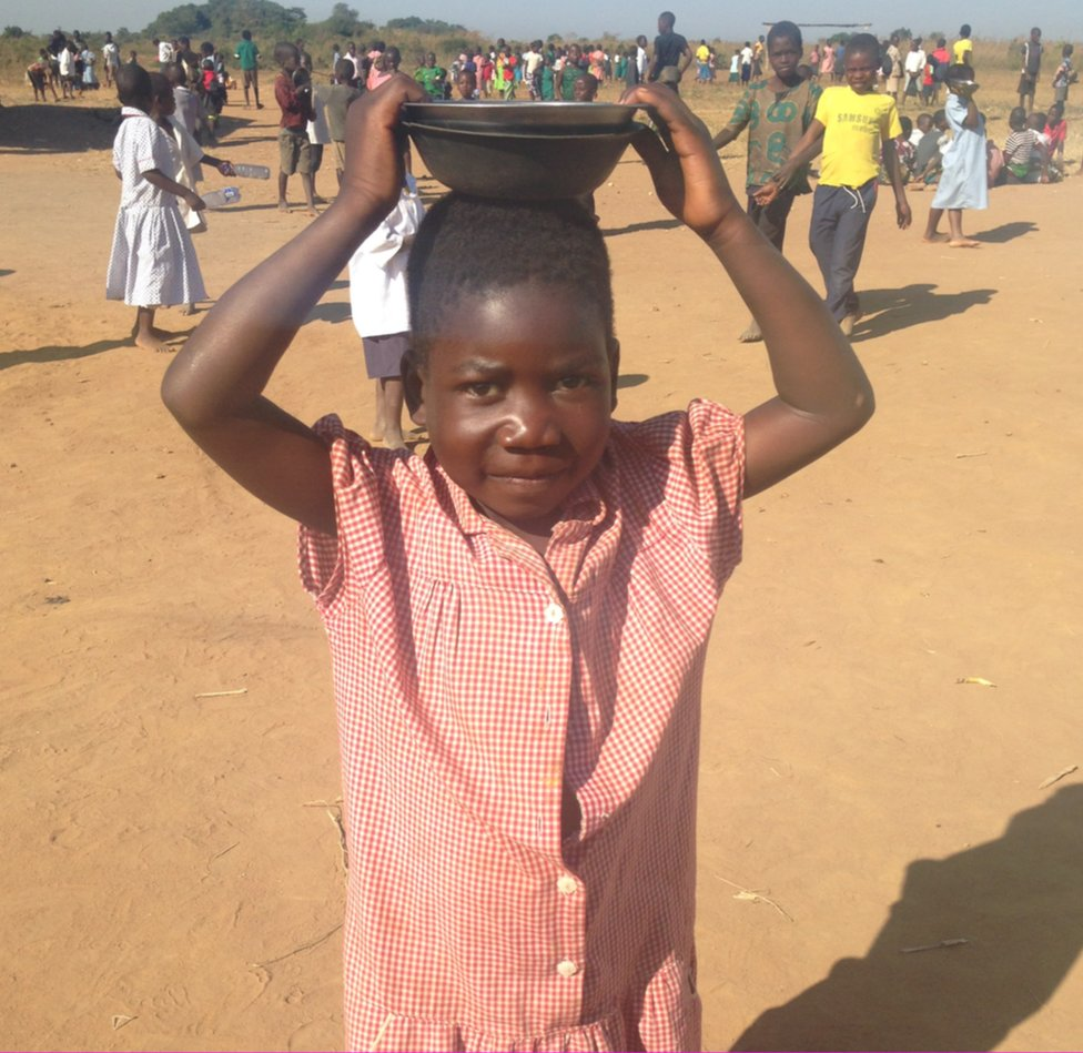 A girl in Malawi, Africa, dressed in a Leicestershire school uniform