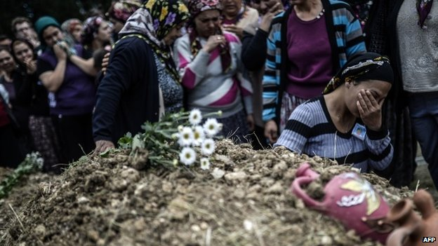Mourners at a funeral - 15 May