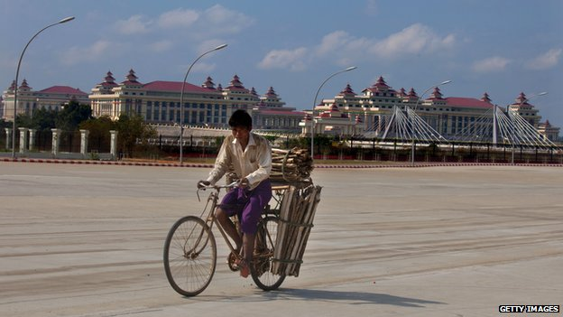 Cyclist in front of the Myanmarese parliament building in the capital Naypyidaw