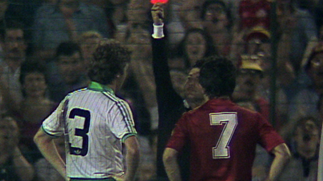 Northern Ireland's Mal Donaghy is sent off against Spain