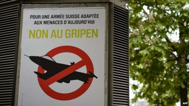 A campaign poster against the Swedish fighter jet Gripen is seen in Geneva (7 May 2014)