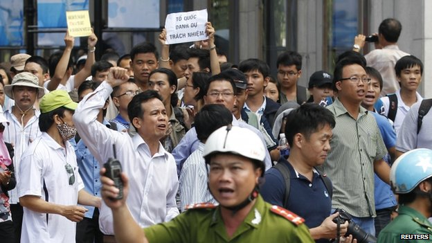 Protesters chant anti-China slogans during an anti-China protest in Ho Chi Minh city on 18 May 2014