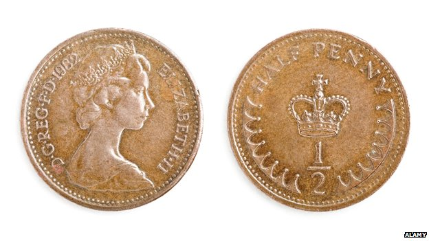 Two sides of a half penny coin