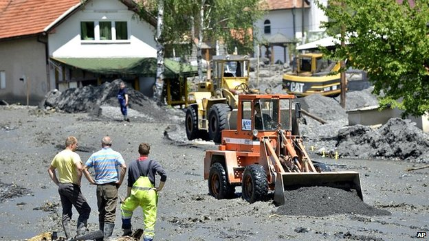 Mechanical diggers clean streets in village of Topcic Polje, damaged in a landslide, near Bosnian town of Zenica. 19 May 2014