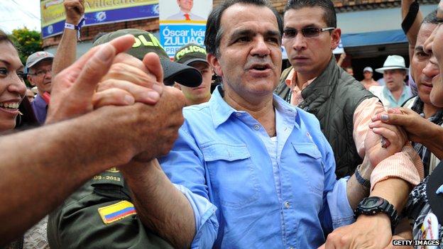 Oscar Zuluaga meets supporters at a rally in Bogota