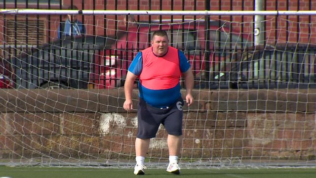 Man standing in football goal