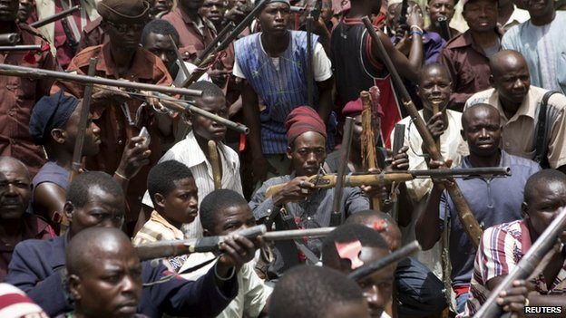 A vigilante group of traditional hunters in a camp in Maiduguri, Nigeria - 21 May 2014