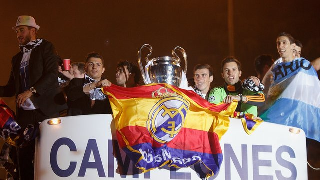 Real Madrid return to hero's welcome