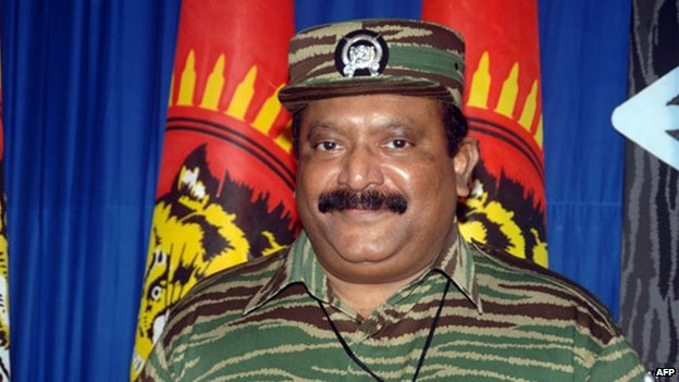 This undated handout picture released by the Liberation Tigers for Tamil Eelam (LTTE), LTTE leader Velupillai Prabhakaran poses at an undisclosed location in Sri Lanka. The leader of Sri Lanka's Tamil Tiger rebels, Velupillai Prabhakaran, was shot dead on 18 May, 2009 while trying to flee government troops.