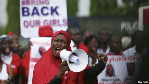 """A protester addresses a """"Bring Back Our Girls"""" rally in Abuja"""