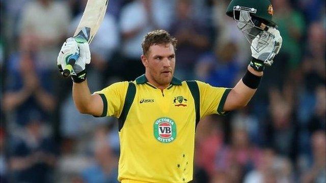 Australia's Aaron Finch celebrates bringing up his century