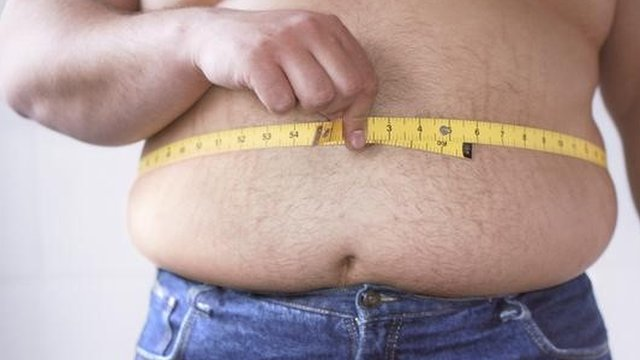Overweight man with tape measure