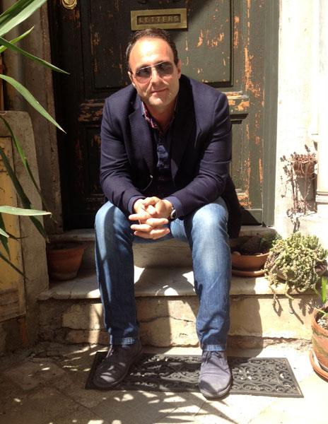 Luigi Di Cicco sitting on a step