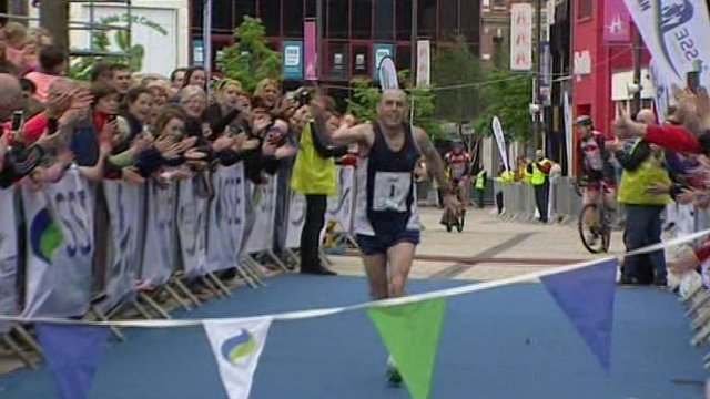 Last year's Walled City Marathon winner Tommy Hughes is about to cross the finishing line in Derry