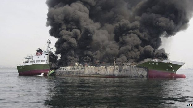 In this photo released by Japan's 5th Regional Coast Guard, clouds of black smoke billow from Shoko Maru, a 998-ton Japanese oil tanker, after it exploded off the southwest coast near Himeji port, western Japan, Thursday, 29 May 2014