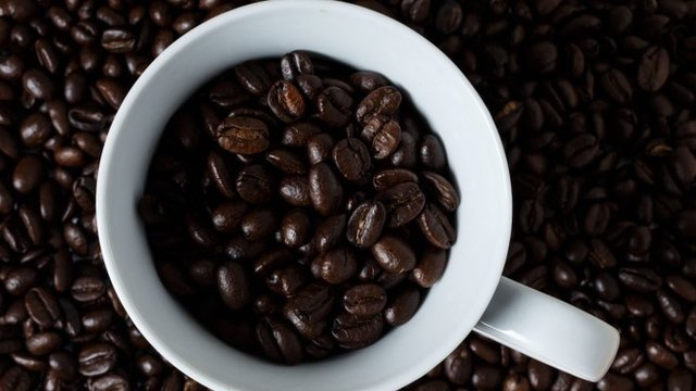 Coffee beans in a mug