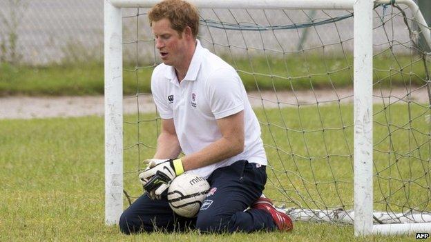 Prince Harry playing football