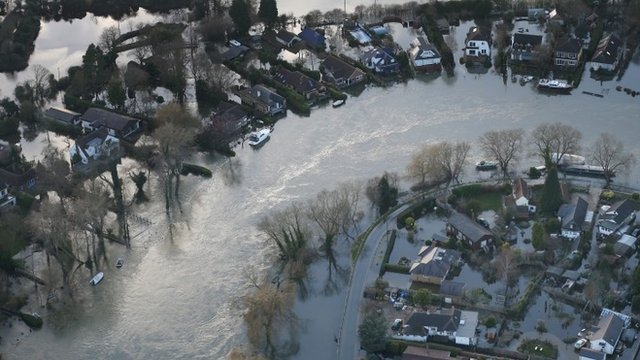 Flood water (flood waters) surrounds houses on February 16, 2014 near Walton on Thames, England.