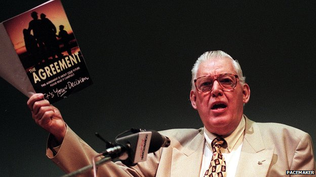Mr Paisley holds aloft the Good Friday Agreement booklet