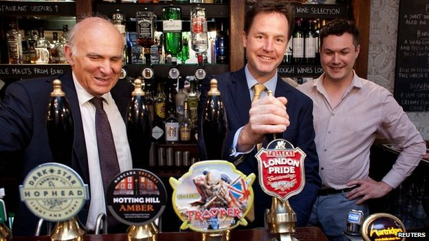 Nick Clegg pulls a pint for the cameras
