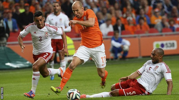 Netherlands forward Arjen Robben takes on the Wales defence