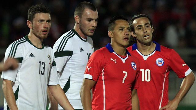 Corry Evans and Luke McCullough of Northern Ireland with Chile's Alexis Sanchez and Jorge Valdivia