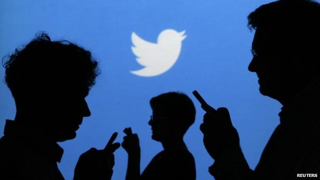 Phone users with Twitter logo