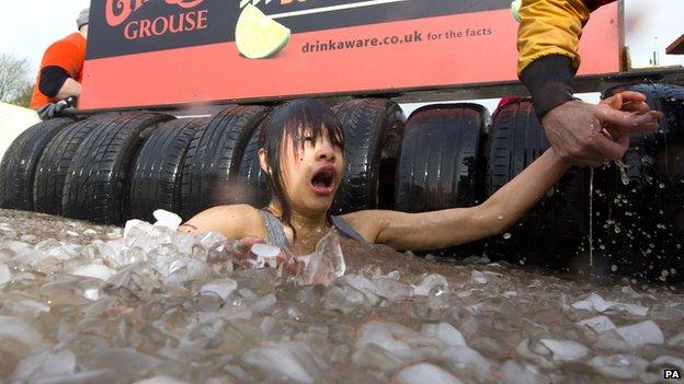 A female participant in a Tough Mudder event
