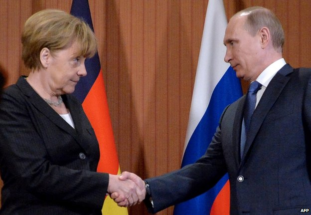 Angela Merkel meets Vladimir Putin in Deauville, France (6 June 2014)