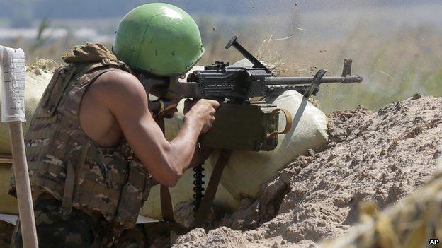 Ukrainian soldier fires machine gun in battle with rebels near Sloviansk - 6 June