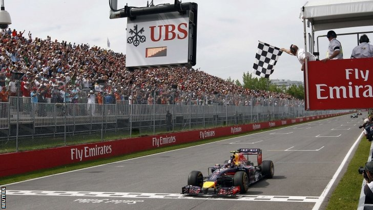 Red Bull Formula One driver Daniel Ricciardo of Australia takes the checkered flag to win the Canadian F1 Grand Prix at the Circuit Gilles Villeneuve