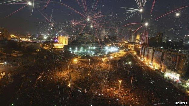 Fireworks explode in Tahrir Square on 8 June 2014