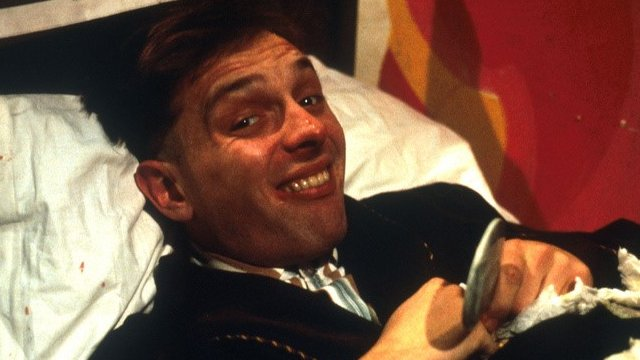 Rik Mayall as Rik in the Young Ones
