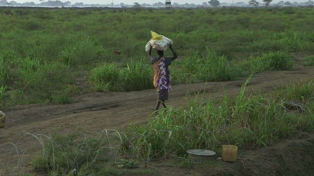 Woman walking in South Sudan