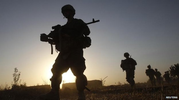 US army soldiers from Charlie company 4th platoon, 1st brigade 3-21 infantry, patrol in the village of Chariagen in the Panjwai district of Kandahar province southern Afghanistan, June 22 , 2011