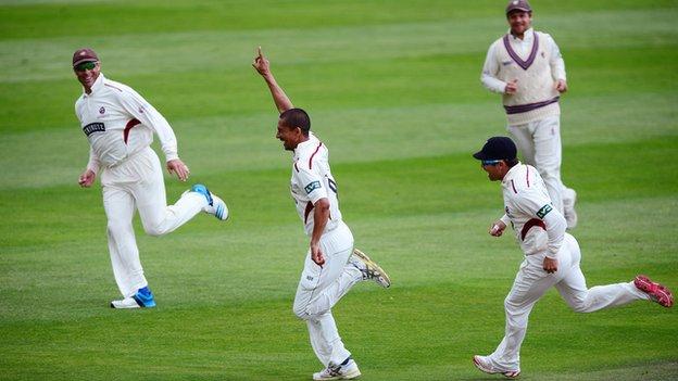 Somerset's Alfonso Thomas celebrates taking a wicket