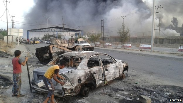 Clashes between Iraqi security forces and ISIS in Mosul. June 2014