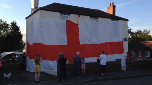 Giant flag covers a house in Blyton