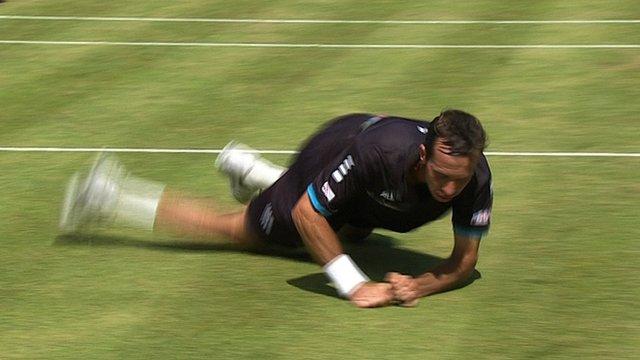 Andy Murray sends Radek Stepanek and his tennis racket tumbling to the ground