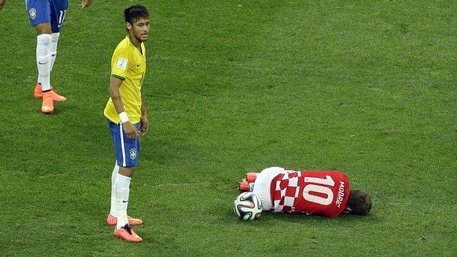 Neymar looks on after fouling Luka Modric