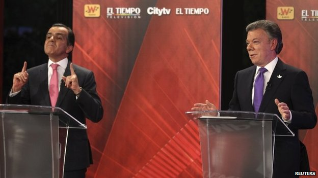 Presidential candidate Oscar Ivan Zuluaga (L) gestures near Colombia's President and presidential candidate Juan Manuel Santos during a television debate