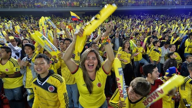 Supporters of the Colombian national football team cheer during the farewell to the squad