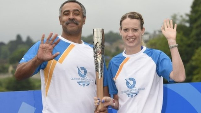 Triple gold medallist Daley Thompson hands the baton to Scottish athlete Eilidh Child on Coldstream bridge