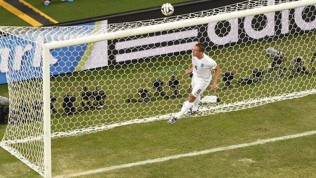 England's Phil Jagielka makes a goal-line clearance