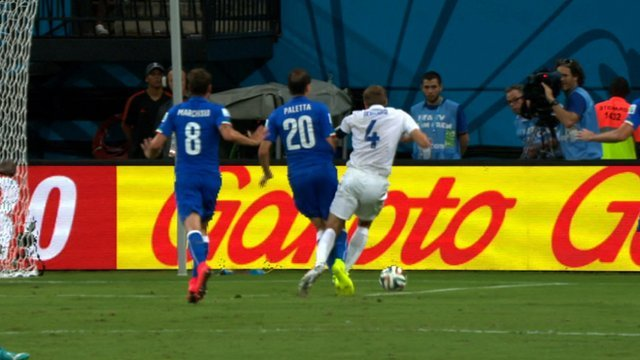 England's Steven Gerrard is nudged off the ball by Gabriel Paletta