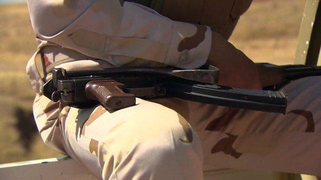 Kurdish fighter with gun